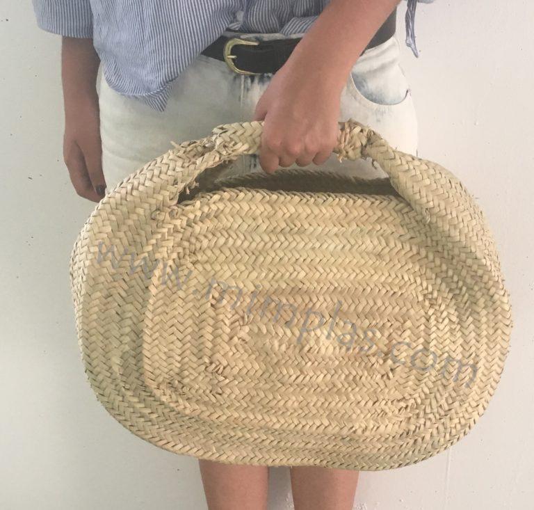 bolso de mano ovalado